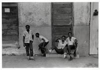 Boys in white shirts on steps, New Orleans