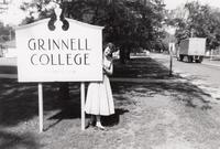 Joanne Bunge by the Grinnell College Sign