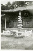 Photo of a Pagoda Statue Outside a Temple