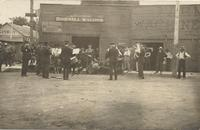 Band playing in front of Birdsell Wagons, Correctionville, Iowa