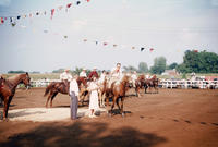 Woman Awarding Ribbon to People on Horseback During 1949 Grinnell Day Celebration