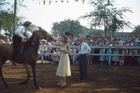 Woman Awarding Ribbon to Person on Horse During 1949 Grinnell Day