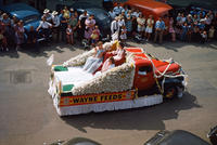 Wayne Feeds Float in 1949 Grinnell Day Parade