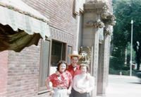 Three People Standing Outside Bank During 1949 Grinnell Day Celebration