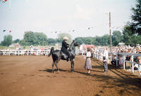 Woman Awarding Ribbon to Man on Horseback During 1948 Grinnell Day