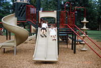 Two Children Sliding on the New Central Park Slides