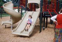 A Child Sliding on the New Central Park Slides