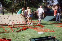 Group of Volunteers Assembling New Central Park Playground Equipment