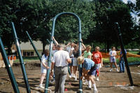 Large Group of Volunteers Assembling New Central Park Playground Equipment