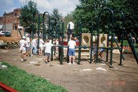 Group of Volunteers Meeting to Assemble Central Park Playground Equipment