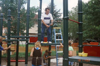 Multigenerational Group Assembling Central Park Playground Equipment