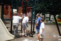 Volunteers Assembling Central Park Playground Equipment