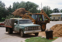 End-loader Dumping Dirt into City Pickup Truck