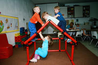 Four Children Climbing on Plastic PIpe House