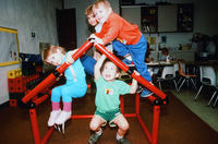 Five Children Climbing on Plastic Pipe House