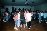 A Group of Teenagers Dancing at The Limit
