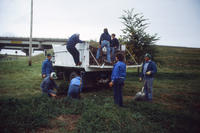 Group of People Unloading Mulch Truck