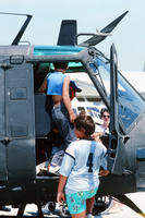 Children Climbing into a Helicopter