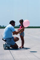 Father and Daughter on the Tarmac