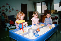 Three Children at a Sand Table