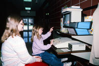 Young Girl Playing a Computer Game