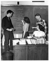 Students Gather at a Blackboard