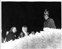Homecoming Queen and Other Women Sitting on a Pep Parade Float