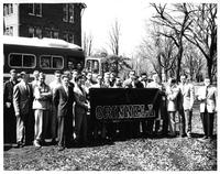 Men's Glee Club Poses in Front of their Tour Bus