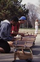 Two Students Play the Xylophone Outside