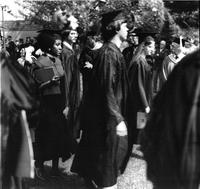 Students standing at commencement