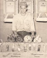 Frank Rowell with his Award Winning Rabbits