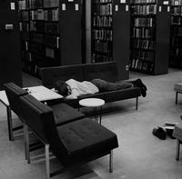 Student Sleeping in Burling Library