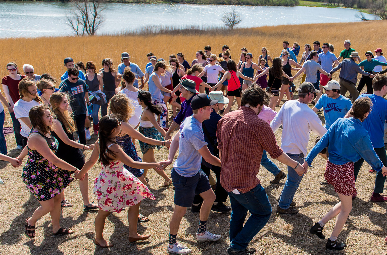 The Grinnell community gathers at the College's [Conard Environmental Research Area](https://www.grinnell.edu/academics/majors-concentrations/biology/cera) to celebrate the National Water Dance in 2016.