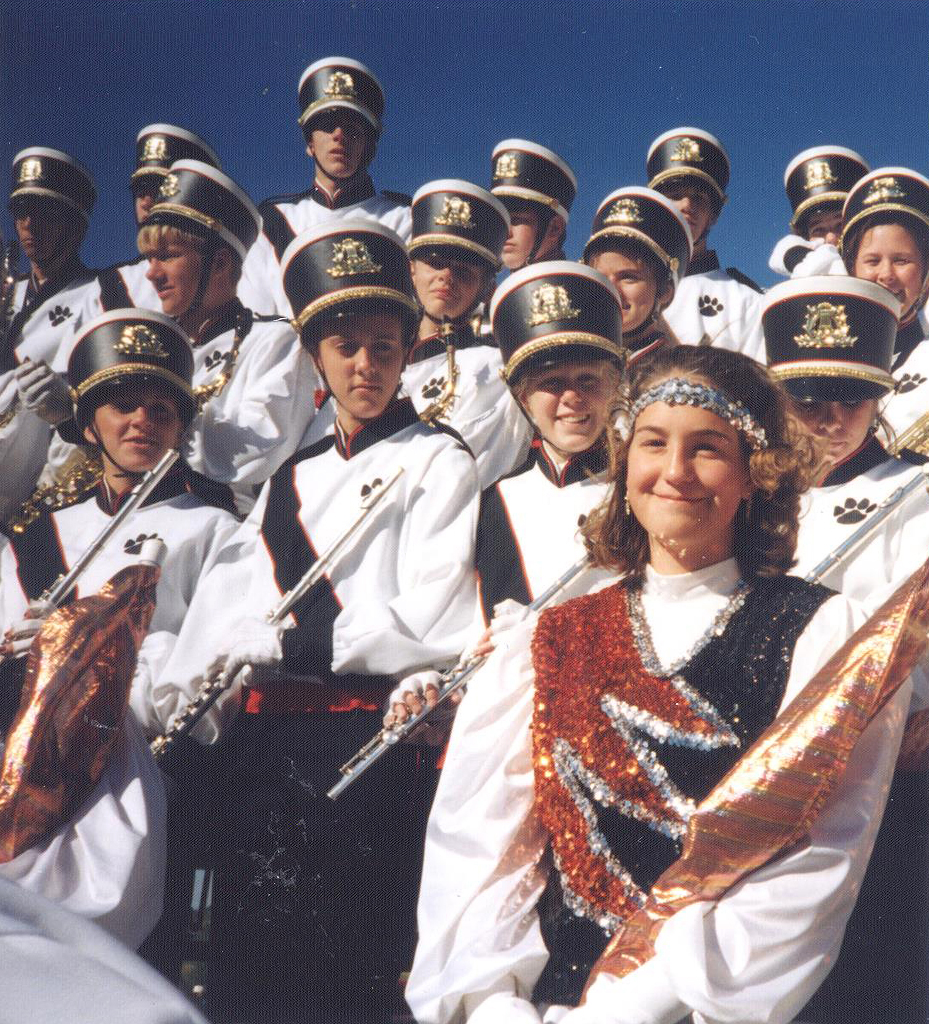 Katie Brandt (lower right corner, wearing headband), performing at the Iowa State Marching Band Festival in high school. Photo courtesy of Bridget Brandt