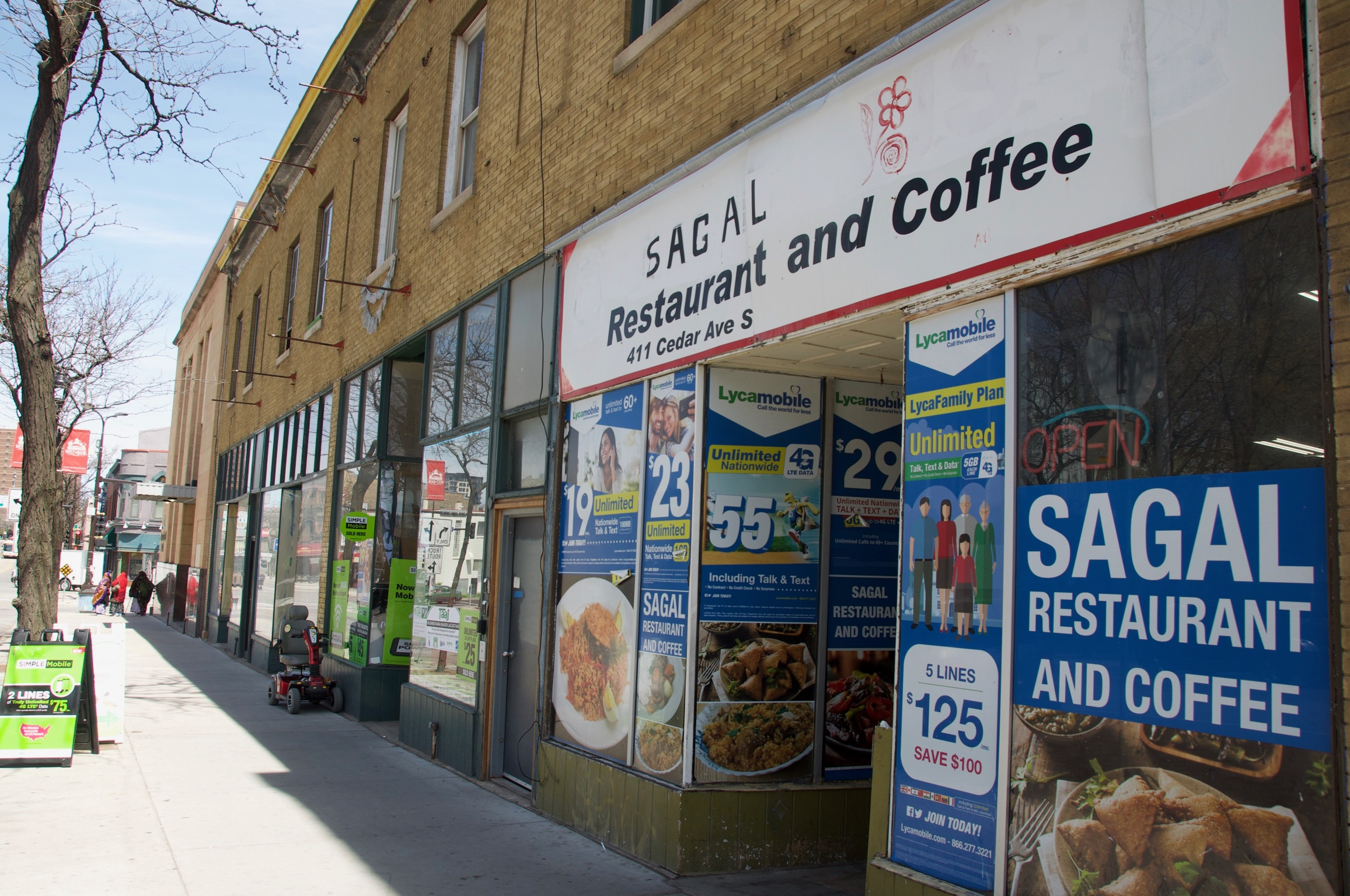 The storefronts in these two images reflect the cultures of the surrounding neighborhood