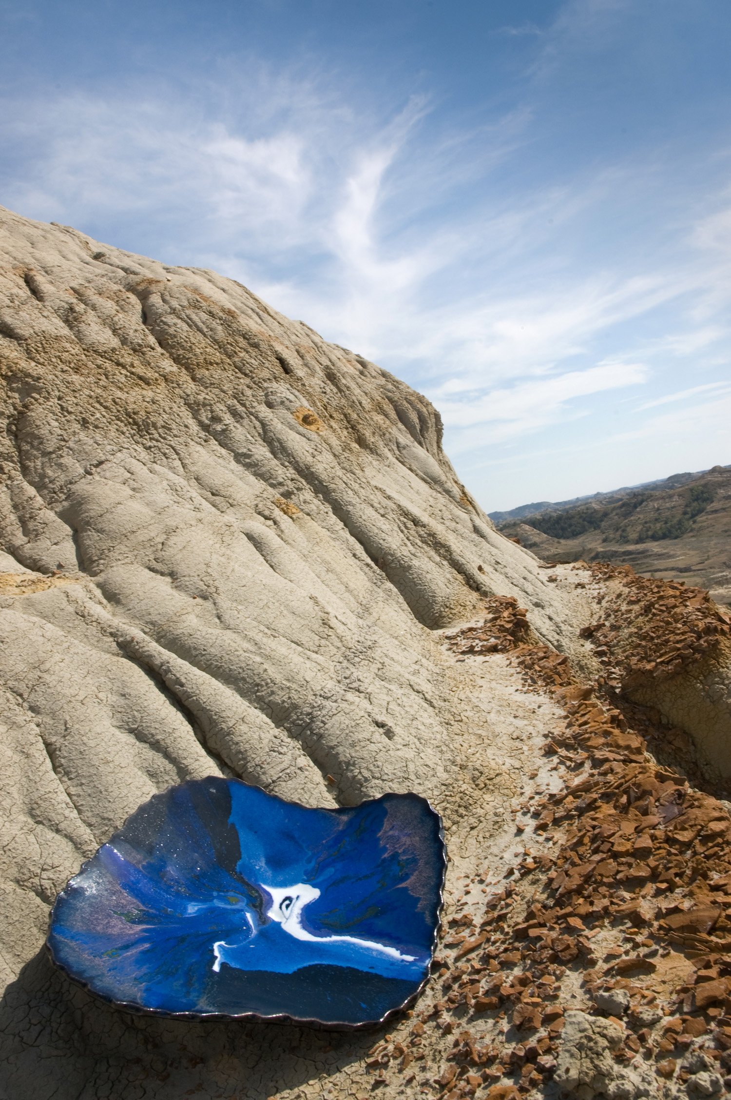 Smith's work reflects the badlands locale in which it's created