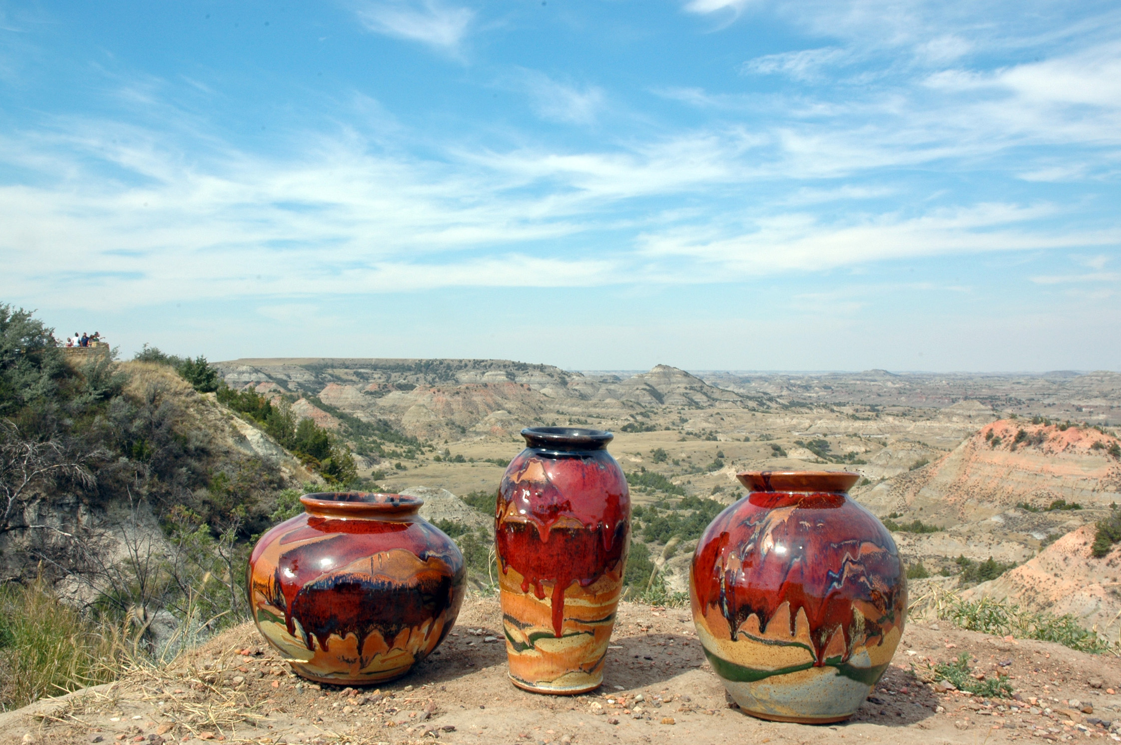 Smith's pottery and the landscape which inspires it, 'striped in the colors of red, tan and black by prairie fires'