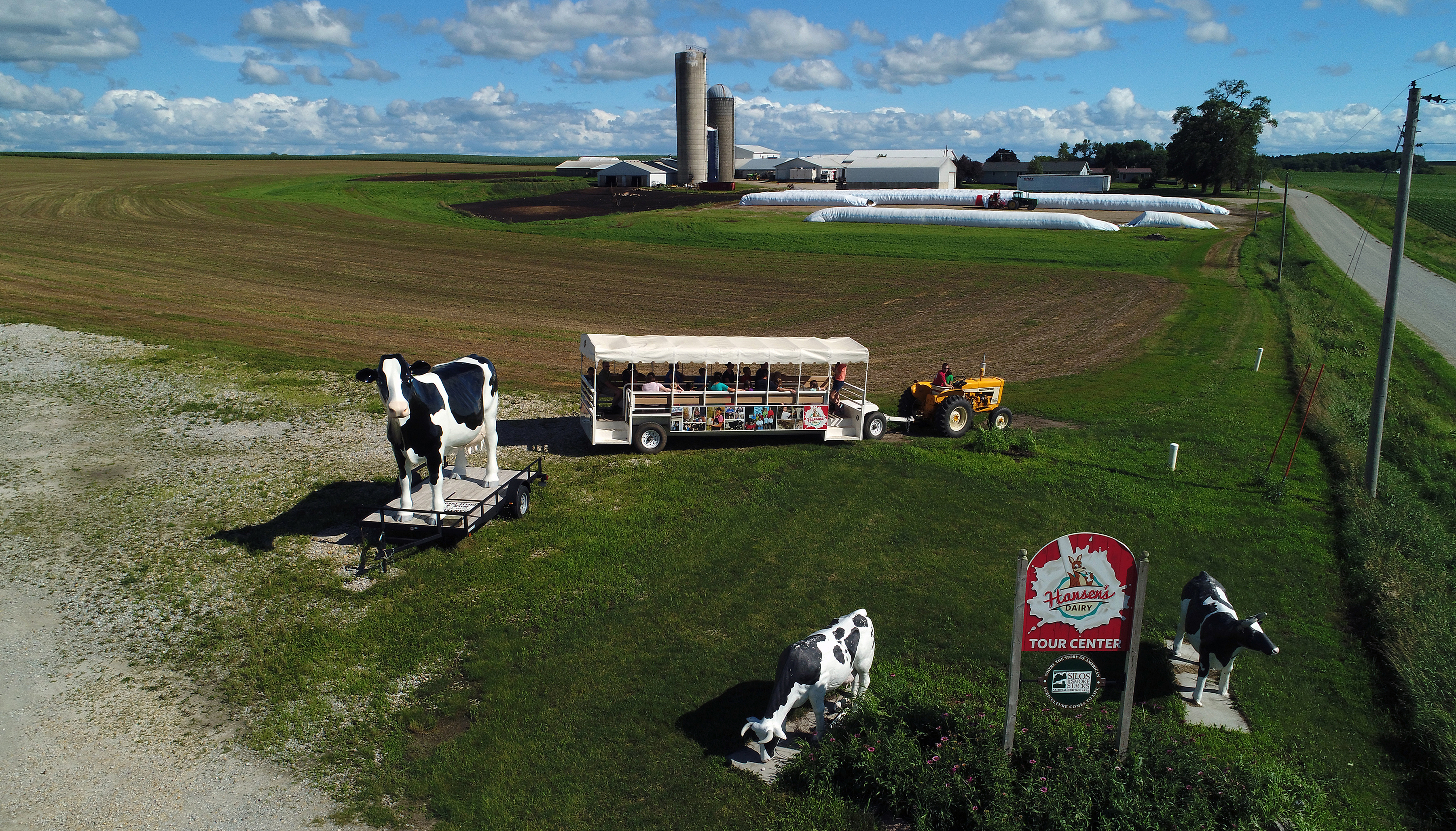 A tour about to get underway at the Hansens' dairy operation in Hudson, Iowa. The trolley takes visitors around the farm to learn how milk gets from the cow to the table
