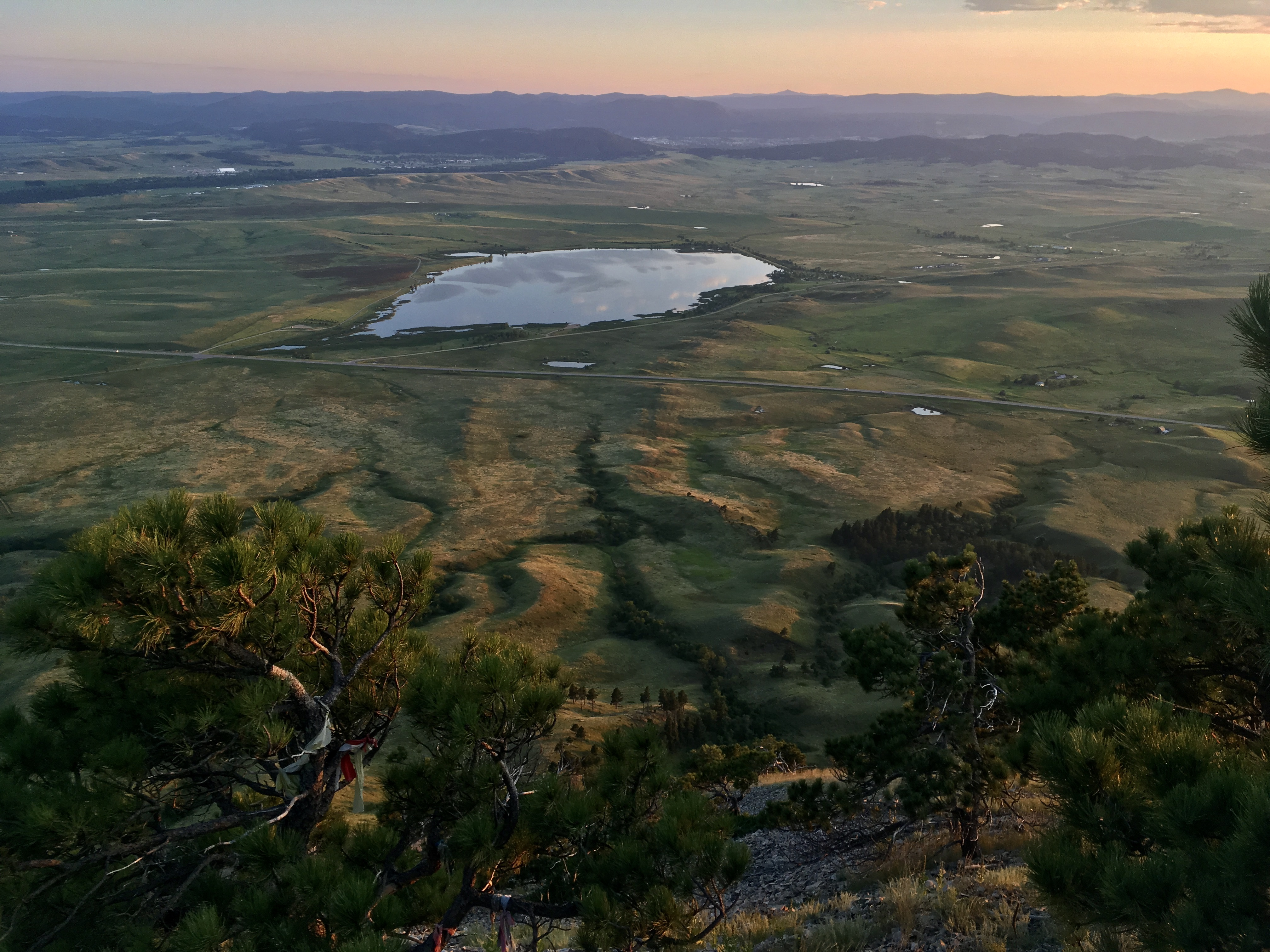 Looking west toward Sturgis from the summit of Bear Butte, SD (northern terminus of GPT pilot trail and Centennial Trail) at sunset.