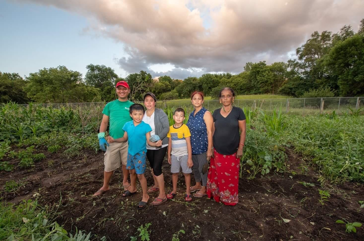 Himal Gurung (at far left) and Indra Gurung (third from far left) with relatives at Global Roots Farm