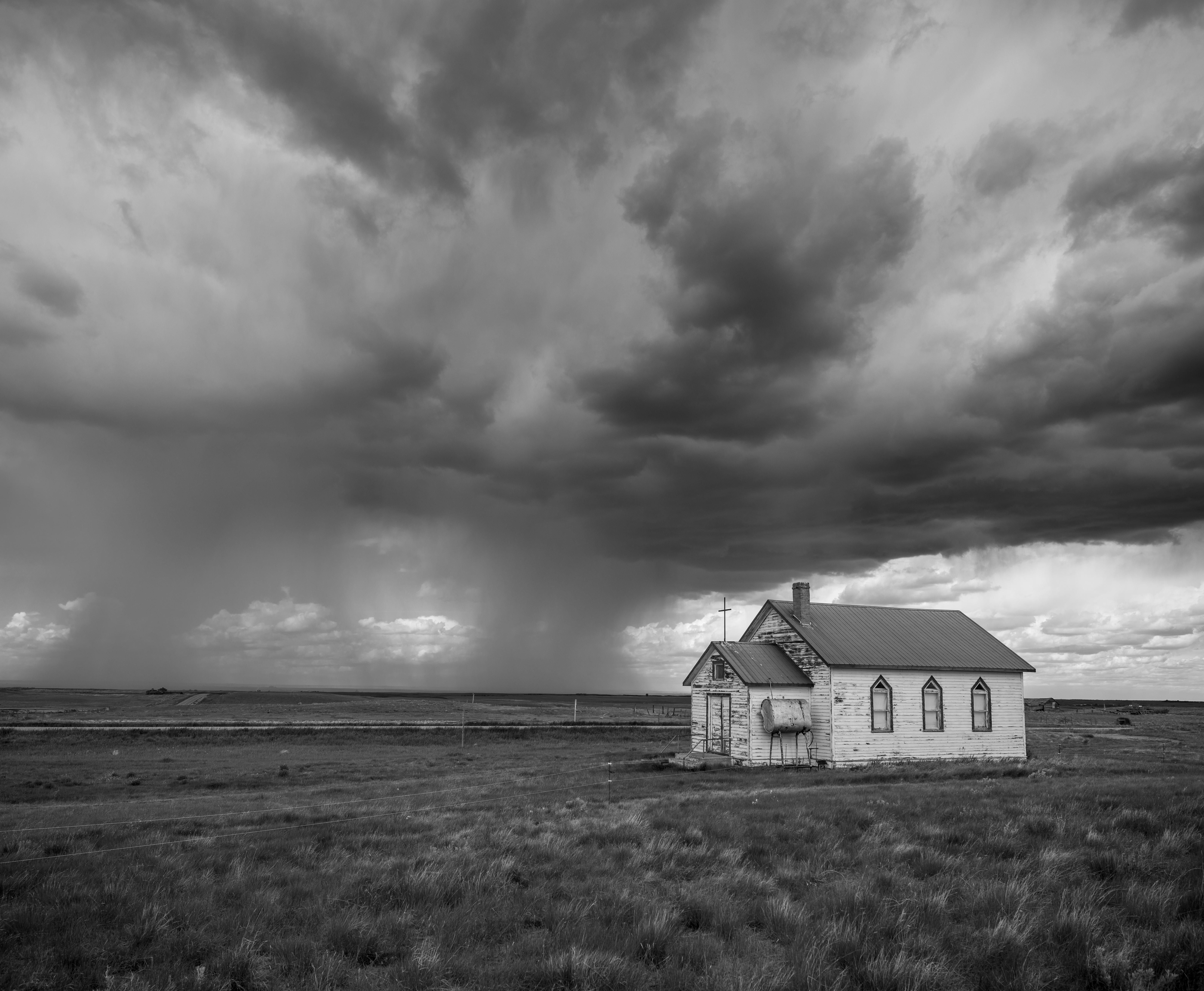 Abandoned school with an approaching storm, Saskatchewan